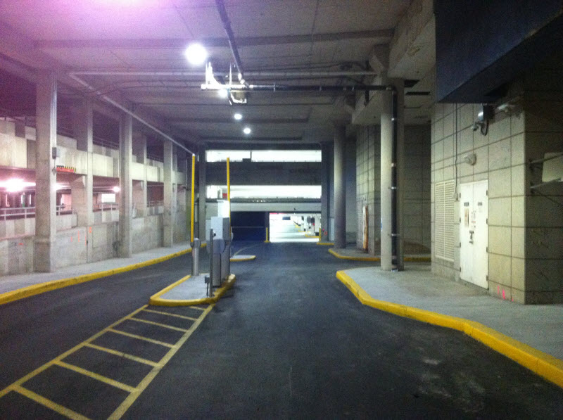 This is the Ramp Down into Parkade E - Level P1, from the North Side of the Mall, Near the Theatre